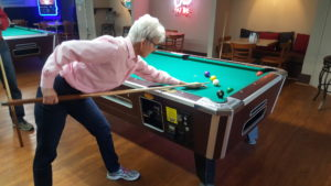 "Sr. Barbara ""Pool Shark"" Kennedy limbers up for the party."