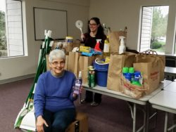 Cleanup drive leader Nyssa Howell (back) shows off the haul with NCC cofounder Sr. Sarah Deeby.
